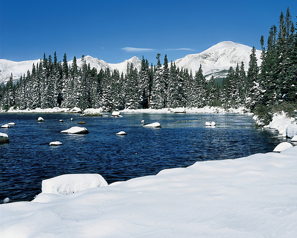 Red Rock Lake and fresh snow in the Indian Peaks Wilderness Area, Boulder, Colorado, USA.