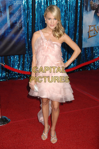 """CARRIE UNDERWOOD. """"Enchanted"""" Los Angeles Premiere at the El Capitan Theatre, Hollywood, California, USA,.17th November 2007..full length pink ruffle dress silver purse hand on hip.CAP/ADM/BP.©Byron Purvis/AdMedia/Capital Pictures."""