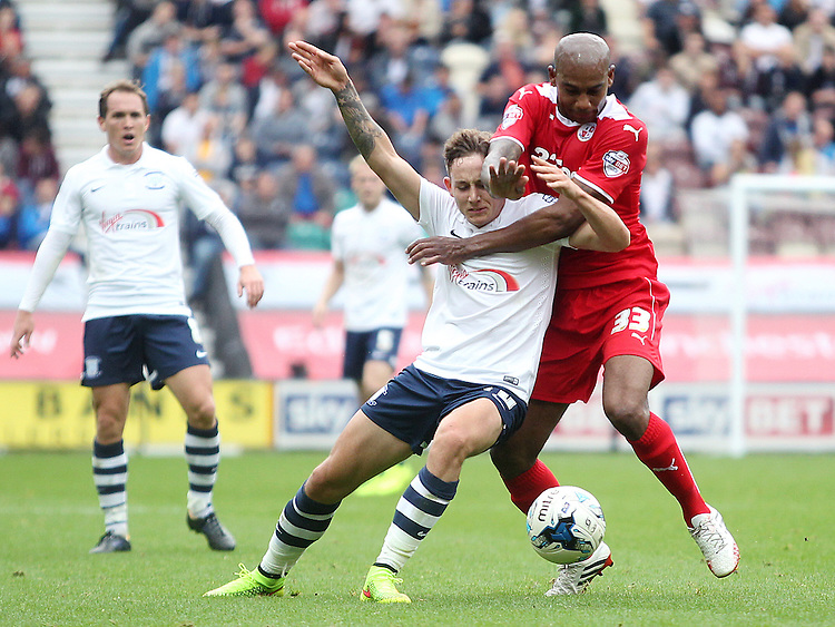 Preston North End's Josh Brownhill battles with Crawley Town's Marvin Elliott<br /> Photographer Rich Linley/CameraSport<br /> <br /> Football - The Football League Sky Bet League One - Preston North End v Crawley Town - Saturday 20th September 2014 - Deepdale - Preston<br /> <br /> &copy; CameraSport - 43 Linden Ave. Countesthorpe. Leicester. England. LE8 5PG - Tel: +44 (0) 116 277 4147 - admin@camerasport.com - www.camerasport.com