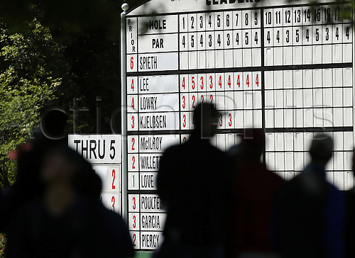 08.04.2016. Augusta, GA, USA - Fans check the leaderboard on the on the sixth hole during the second round of the 80th Masters at the Augusta National Golf Club, Friday, April 8, 2016 in Augusta, Ga