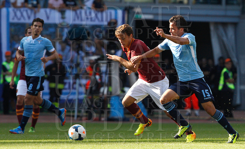 Calcio, Serie A: Roma vs Lazio. Roma, stadio Olimpico, 22 settembre 2013.<br /> AS Roma forward Adem Ljajic, of Serbia,  is challenged by Lazio midfielder Hernanes, of Brazil, right, during the Italian Serie A football match between AS Roma and Lazio, at Rome's Olympic stadium, 22 September 2013.<br /> UPDATE IMAGES PRESS/Riccardo De Luca