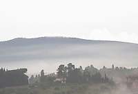 Early morning fog in the Tuscan hills near Siena