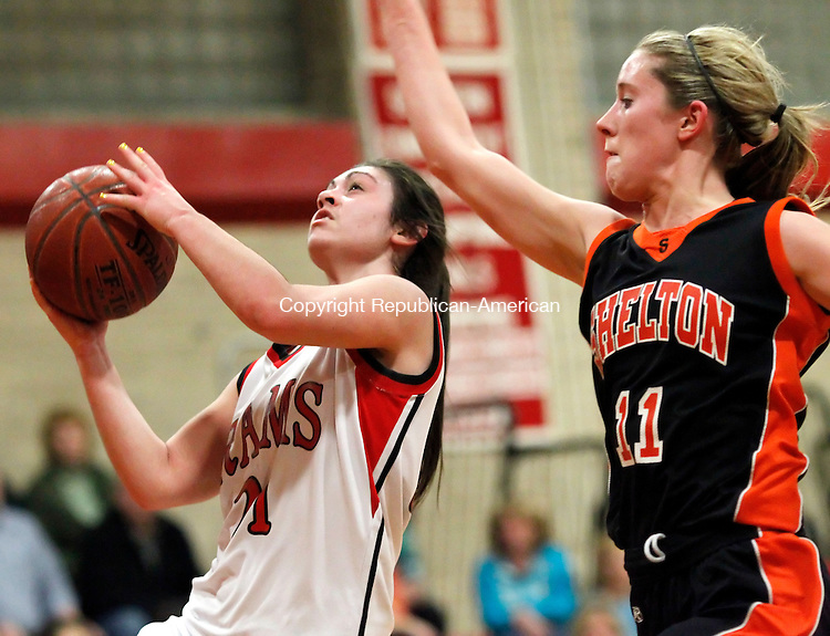 Cheshire, CT-19 January 2012-011912CM10- Cheshire's Melissa Bailey (21) goes up for two as Shelton's Kelsey Pendagast (11) defends during their matchup in Cheshire Thursday night. The Rams won, 61-49.   Christopher Massa Republican-American