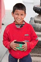 Bodhnath, Nepal.   Young Nepali Boy at the Buddhist Stupa of Bodhnath.