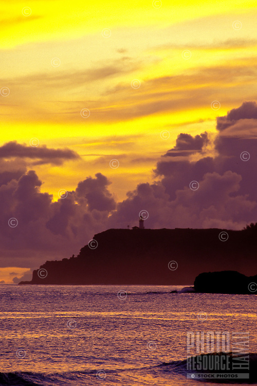 Kilauea lighthouse on Kauai's north shore with sunrise from Anini