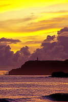 Kilauea lighthouse on Kauai's north shore with sunrise from Anini