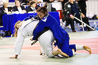 27 MAR 2011 - SHEFFIELD, GBR - Natalie Powell (white) v Megan Fletcher (blue) - English Senior Open Judo Championships .(PHOTO (C) NIGEL FARROW)