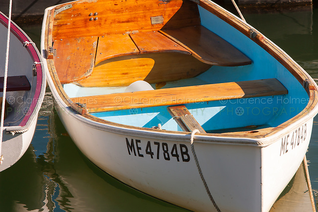 Wooden dinghies anchored in the harbor in Rockport, Maine.