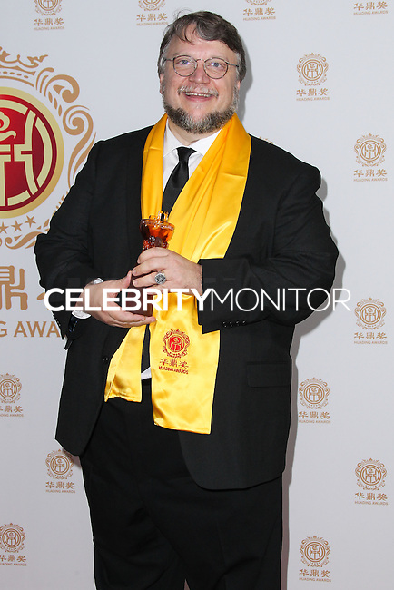 HOLLYWOOD, LOS ANGELES, CA, USA - JUNE 01: Director Guillermo del Toro poses with the award for Best Global Director in the press room at the 12th Annual Huading Film Awards held at the Montalban Theatre on June 1, 2014 in Hollywood, Los Angeles, California, United States. (Photo by Xavier Collin/Celebrity Monitor)