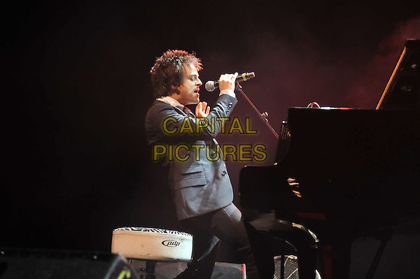 Jamie Cullum.Performing live in concert at The Forum, Kentish Town, London, England..18th October 2011.stage gig performance music in on half length black suit singing piano side profile sitting .CAP/MAR.© Martin Harris/Capital Pictures.