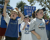 A trio of young San Jose Earthquakes fans cheer at the Soccer Silicon Valley rally held in downtown San Jose, CA on August 20, 2004.  The non-profit Soccer Silicon Valley group hope to find a local buyer or soccer specific stadium for the Earthquakes within the next month so the team is not relocated to San Antonio or Houston, TX by its current investor/operator Anschutz Entertainment Group.