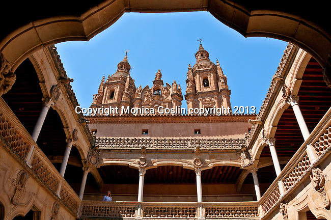 Casa de las Conchas 15th century courtyard with a view of the University of Salamanca in the background. Casa de las Conchas was originally a palace but is now a public library