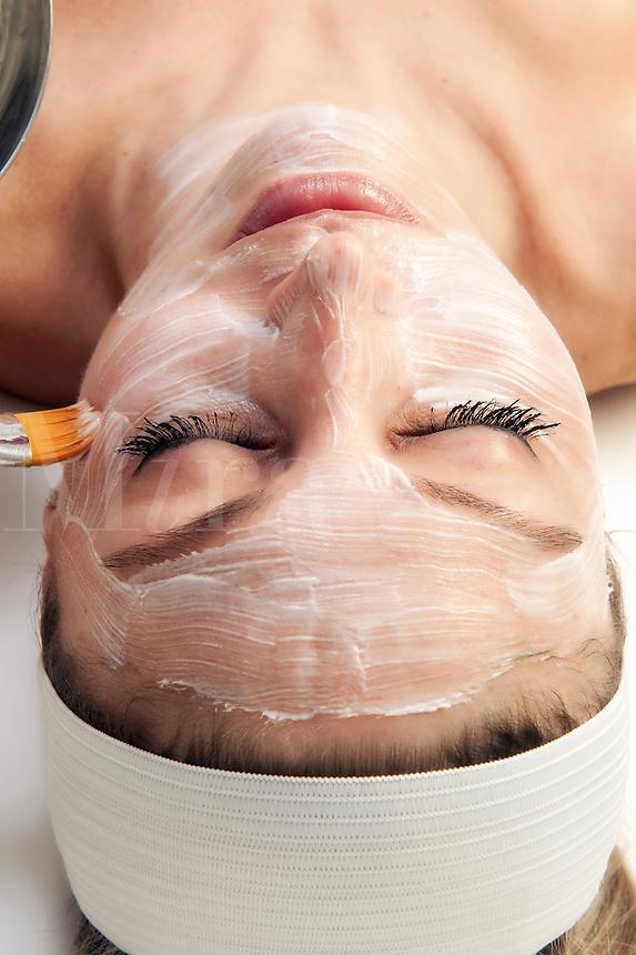 Woman getting a facial tratment at a spa.