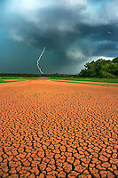 An approaching thunderstorm offers hope of quenching rainfall for a parched landscape at Lake Thunderbird in Norman Oklahoma during a severe drought in July 2006.