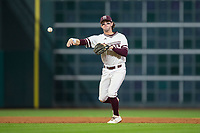 Mississippi State Bulldogs shortstop Luke Alexander (7) makes a throw to first base against the Houston Cougars in game six of the 2018 Shriners Hospitals for Children College Classic at Minute Maid Park on March 3, 2018 in Houston, Texas. The Bulldogs defeated the Cougars 3-2 in 12 innings. (Brian Westerholt/Four Seam Images)