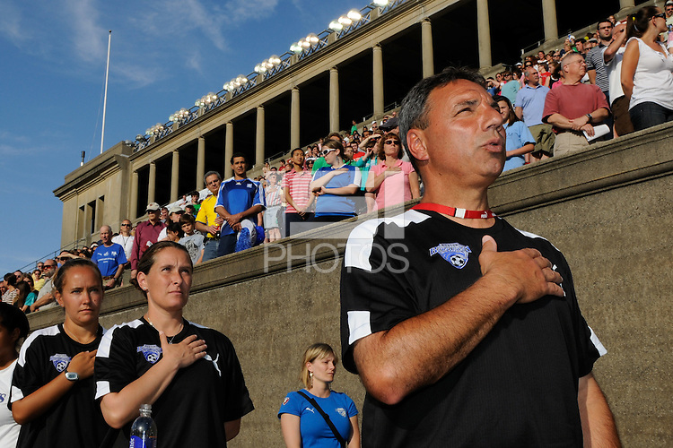Boston Breakers head coach Tony DiCicco, assistant coaches Lisa Cole, and Katie Shields during the national anthem. Sky Blue FC defeated the Boston Breakers 2-1 during a WPS regular season match at Harvard Stadium in Boston, MA, on July 12, 2009.