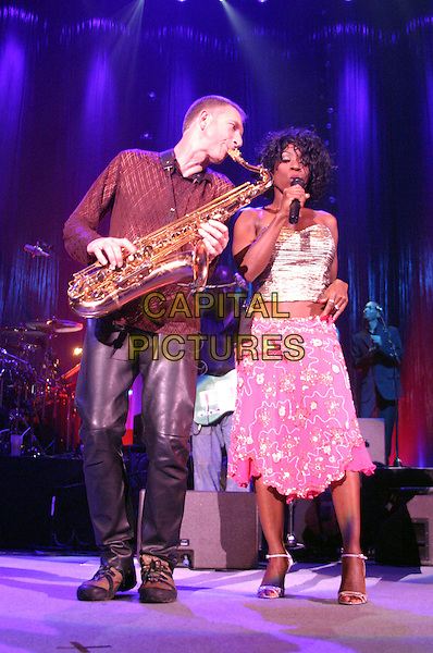 HEATHER SMALL .M People .plays Nottingham Arena..UK, United Kingdom..Ref: JEZ.30th September 2005.full length saxophone player M People live on stage performing gig sing singing mpeople m-people holding microphone pastel pink strapless boobtube silk satin bright sequinned skirt.www.capitalpictures.com.sales@capitalpictures.com.©Capital Pictures.
