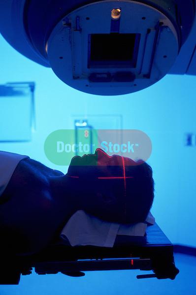 Man on radiation therapy machine