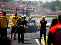 May 6, 2017; Commerce, GA, USA; Crew members with NHRA top fuel driver Troy Coughlin Jr during qualifying for the Southern Nationals at Atlanta Dragway. Mandatory Credit: Mark J. Rebilas-USA TODAY Sports