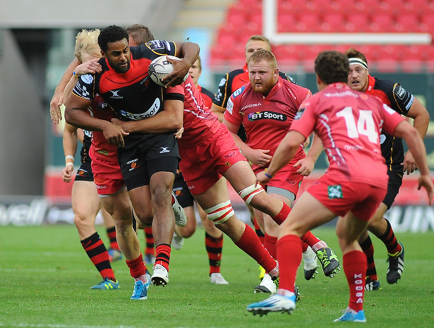 Newport Gwent Dragons' Aled Brew is tackled by Scarlets' Johan Snyman <br /> <br /> Photographer Kevin Barnes/CameraSport<br /> <br /> Rugby Union - Guinness PRO12 - Scarlets v Newport Gwent Dragons - Sunday 05th October 2014 - Parc y Scarlets - Llanelli<br /> <br /> &copy; CameraSport - 43 Linden Ave. Countesthorpe. Leicester. England. LE8 5PG - Tel: +44 (0) 116 277 4147 - admin@camerasport.com - www.camerasport.com