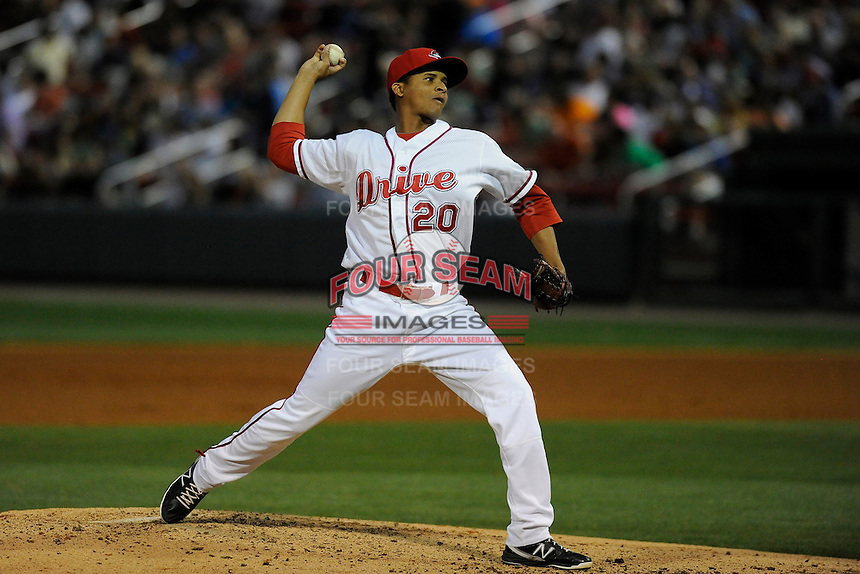 Relief pitcher Yunior Ortega (20) of the Greenville Drive in a game against the Delmarva Shorebirds on Friday, April 26, 2013, at Fluor Field at the West End in Greenville, South Carolina. Delmarva won, 10-3. (Tom Priddy/Four Seam Images)