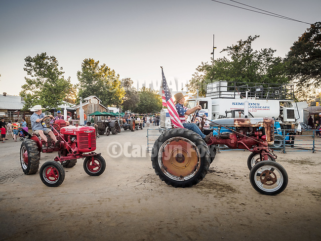 Tractor parade.<br /> <br /> Saturday, Day 3 of the 79th Amador County Fair, Plymouth, Calif.<br /> <br /> Local cowboy ranch rodeo, livestock beauty pageant, youth tractor rodeo, Mutton Bustin' finals<br /> <br /> <br /> #AmadorCountyFair, #PlymouthCalifornia,<br /> #TourAmador, #VisitAmador