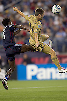 New England Revolution defender Emmanuel Osei (5) and second half substitute Philadelphia Union forward Jack McInerney (19) battle for a crossed ball. The Philadelphia Union defeated New England Revolution, 2-1, at Gillette Stadium on August 28, 2010.