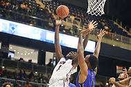 Washington, DC - December 22, 2018: Howard Bison center Akuwovo Ogheneyole (12) is fouled by Hampton Pirates forward Ricquall Smoot (0) during the DC Hoops Fest between Hampton and Howard at  Entertainment and Sports Arena in Washington, DC.   (Photo by Elliott Brown/Media Images International)