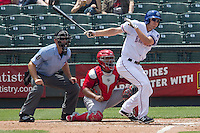 Round Rock Express outfielder Jared Hoying #30 follows through on his swing during the Pacific Coast League baseball game against the Memphis Redbirds on April 27, 2014 at the Dell Diamond in Round Rock, Texas. The Express defeated the Redbirds 6-2. (Andrew Woolley/Four Seam Images)