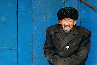 A Uyghur man bundles up on cold winter day in the ancient oasis city of Kashgar. The Uyghurs of China's Xinjiang Uyghur Autonomous Region speak Uyghur, a Turkic language, and are ethnic Turkic 'cousins' to the Kyrgyz, the Kazakhs, the Uzbeks.