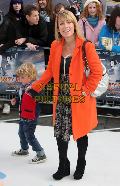 guest & Fay Ripley.European Premiere of 'Happy Feet Two' at the Empire Leicester Square, London, England..November 20th 2011.full length black boots grey gray print dress holding hands kids child orange jacket.CAP/ROS.©Steve Ross/Capital Pictures