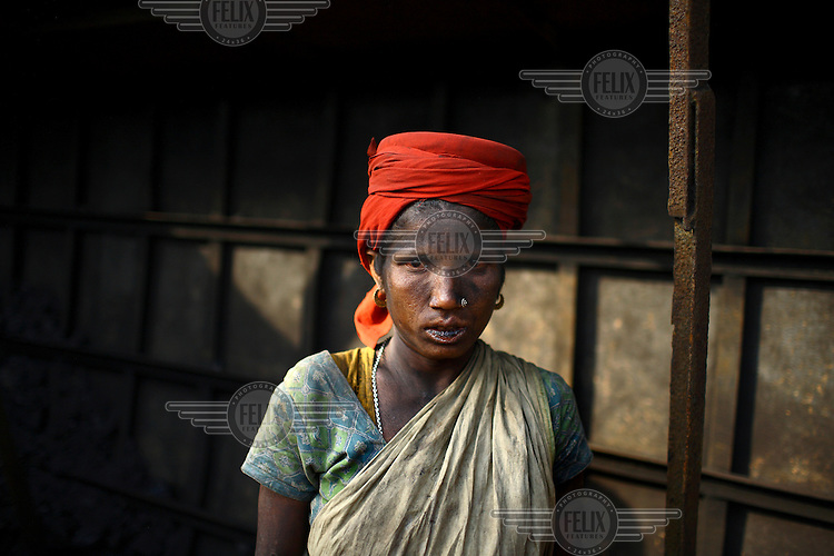 A female labourer working at a brick making factory in Gazipur. For each thousand bricks they move the labourers are paid the equivalent of about GBP 0.56.