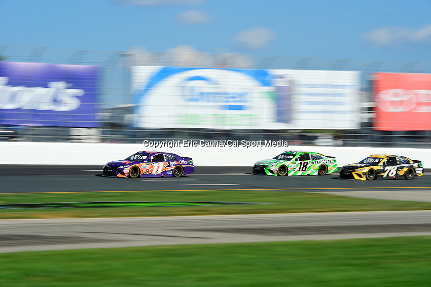 July 16, 2017 - Loudon, New Hampshire, U.S. - Denny Hamlin, Monster Energy NASCAR Cup Series driver of the FedEx Office Toyota (11), leads Kyle Busch, driver of the Interstate Batteries Toyota (18), and Martin Truex Jr, driver of the Wix Filters Toyota (78), during in the NASCAR Monster Energy Overton's 301 race held at the New Hampshire Motor Speedway in Loudon, New Hampshire. Larson placed first in the qualifier. Eric Canha/CSM