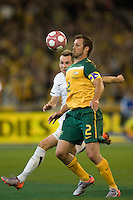 MELBOURNE, AUSTRALIA - MAY 24, 2010: Lucas Neill of the Qantas Socceroos controls the ball at the FIFA World Cup farewell match between Australia and New Zealand at the Melbourne Cricket Ground, 24 May, 2010 in Melbourne, Australia. Photo by Sydney Low / www.syd-low.com