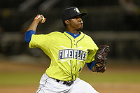 Pitcher Ezequiel Zabaleta (4) of the Columbia Fireflies delivers a pitch in a game against the Charleston RiverDogs on Thursday, April 4, 2019, at Segra Park in Columbia, South Carolina. Charleston won, 2-1. (Tom Priddy/Four Seam Images)