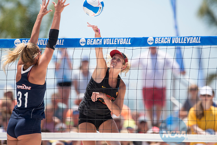GULF SHORES, AL - MAY 07: Abril Bustamante (10) of the University of Southern California hits the ball past Deanna Kraft (31) of Pepperdine University during the Division I Women's Beach Volleyball Championship held at Gulf Place on May 7, 2017 in Gulf Shores, Alabama. The University of Southern California defeated Pepperdine 3-2 to claim the national championship. (Photo by Stephen Nowland/NCAA Photos via Getty Images)