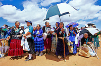 Navajo elders, mostly women, watch events at Fairgrounds during the Pioneer Day Fair at Navajo Mountain, Navajo Nation, Navajo Mountain, Utah, AGPix_0631..