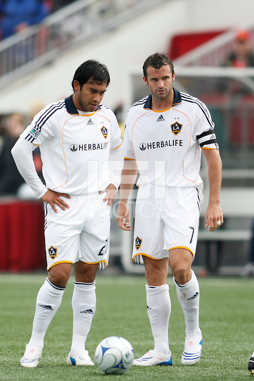 Los Angeles Galaxy forward Carlos Ruiz (20) discusses a free kick with defender Chris Klein (7). Toronto FC defeated the Los Angeles Galaxy 2-0 during a Major League Soccer match at BMO Field in Toronto, Ontario, Canada, on May 31, 2008.