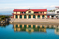 Reflection of The Boatshed in Wellington Harbour, North Island, New Zealand. This photo shows The Boatshed, based in Wellington Harbour.
