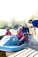 (l to R) Brianca Williams, Ahbria Bradley, Ardell Williams, and Ahmari Bradley on the paddle boats at Pullen Park.