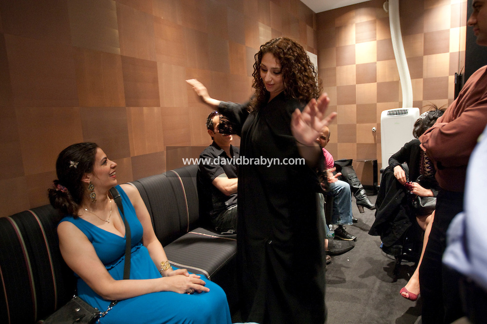 Comedians participating in the 6th Annual NY Arab-American Comedy Festival chat in the changing room before the start of the show in New York, USA, 10 May 2009.