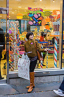 Leafletting at a protest by retail workers and union supporters in front of Dylan's Candy Bar in the Upper East Side neighborhood of New York on Wednesday, October 30, 2013.  The workers chose the Halloween holiday to demand a living wage and more hours of work. (© Richard B. Levine)