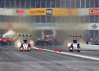 Apr 21, 2018; Baytown, TX, USA; NHRA top fuel driver Doug Kalitta (left) races alongside Billy Torrence during qualifying for the Springnationals at Royal Purple Raceway. Mandatory Credit: Mark J. Rebilas-USA TODAY Sports