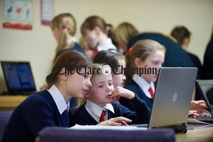 Safiya Sasaskaya and Katelyn O Donnell in computer class at Killaloe Convent primary school. Photograph by John Kelly.