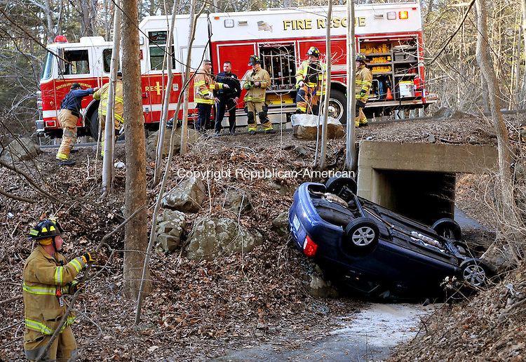 SOUTHBURY,  CT, 31 JANUARY  2012-013112JS01-A car driven by Mary A. Morrell plunged over the side of Krueger Drive in Southbury on Tuesday and onto a golf cart path. Morrello escaped serious injuries in the accident. .Jim Shannon Republican-American