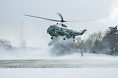 Marine One comes in for a landing on the snow covered South Lawn of the White House in Washington, District of Columbia, U.S., on Wednesday, Jan. 7, 2015.  United States President Barack Obama is traveling to the Ford Michigan Assembly Plant in Wayne, Michigan to deliver remarks highlighting the workers in the resurgent American automotive and manufacturing sector now that the auto rescue has been completed and the decision to save the auto industry and the over one million jobs that went with it. <br /> Credit: Pete Marovich / Pool via CNP