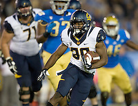 Jeffrey Coprich of California runs the ball during the game against UCLA at Rose Bowl in Pasadena, California on October 12th, 2013.   UCLA defeated California, 37-10.