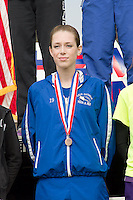 Valle Catholic senior Neve Cavanaugh stands with her 18th place medal during the awards presentation at the State Cross Country Championships in Jefferson City, Saturday, November 3. Cavanaugh led Valle Catholic to a 5th place finish in Class 1, just missing a state trophy by seven points.