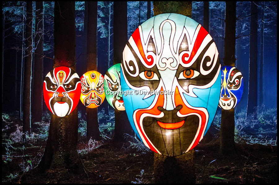 BNPS.co.uk (01202 558833)<br /> Pic: DavidMcGirr/BNPS<br /> <br /> ***Please Use Full Byline***<br /> <br /> Spooky - Huge Chinese masks are placed in the woods.<br /> <br /> The largest Chinese 'Festival of Light' seen in Europe is taking shape at the Longleat House in Wiltshire - A small army of over 50 skillled workers have flown in from the remote village of Zigong in central China to create the stunning spectacle.<br /> <br /> Among the different scenes are a 20-metre tall Chinese temple, a 70-metre-long dragon, created using more than 10,000 porcelain cups, bowls, plates and dishes, and the mythical qilin &ndash; a chimerical hooved creature with the head of a lion &ndash; featuring more than 30,000 glass phials filled with coloured liquid.<br /> <br /> Massive traditional Chinese masks are also featured and there is also a bamboo forest which is home to a family of life-size pandas, giant elephants, zebras, lions and deer as well as giant lotus flowers floating on the lake.<br /> <br /> Filled with thousands of LED lights and handmade by a team of 50 highly-skilled craftsmen from Zigong in China's Sichuan province, the lanterns recreate a magical world of myths and legends.<br /> <br /> Set amid the beautiful backdrop of the landscaped grounds and gardens surrounding Longleat House, the lit structures also spill out on to Half Mile Lake to create a stunning and enchanting experience for visitors.<br /> <br /> It&rsquo;s the first time a festival of this size has taken place in the UK and the Chinese team behind the spectacular event believe its size and complexity make it unique throughout Europe.