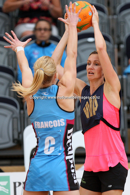 Legend's Adine Wilson, right, looks to pass the ball over Steel's Shannon Francois in the Steel v Legends match, Edgar Centre, Dunedin, New Zealand, Saturday, March 16, 2013. Credit:NINZ/Dianne Manson